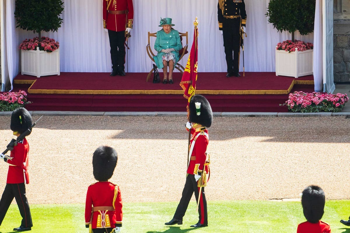 The Queen views a military ceremony by soldiers from the 1st Battalion Welsh Guards in the Quadrangle of Windsor Castle in Windsor, west of London on June 13, 2020. (AFP)