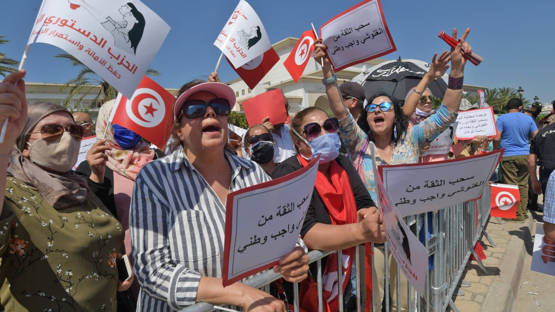Supporters of the Free Destourian Party (PDL) rally against Assembly President Rached Ghannouchi outside the Tunisian parliament in Tunis on June 3, 2020. Ghannouchi, leader of the Islamist-inspired Ennahdha party, overshadows the President of the Republic Kais Saied on the diplomatic scene, a sign of deep tensions despite the sacred union during the health crisis.