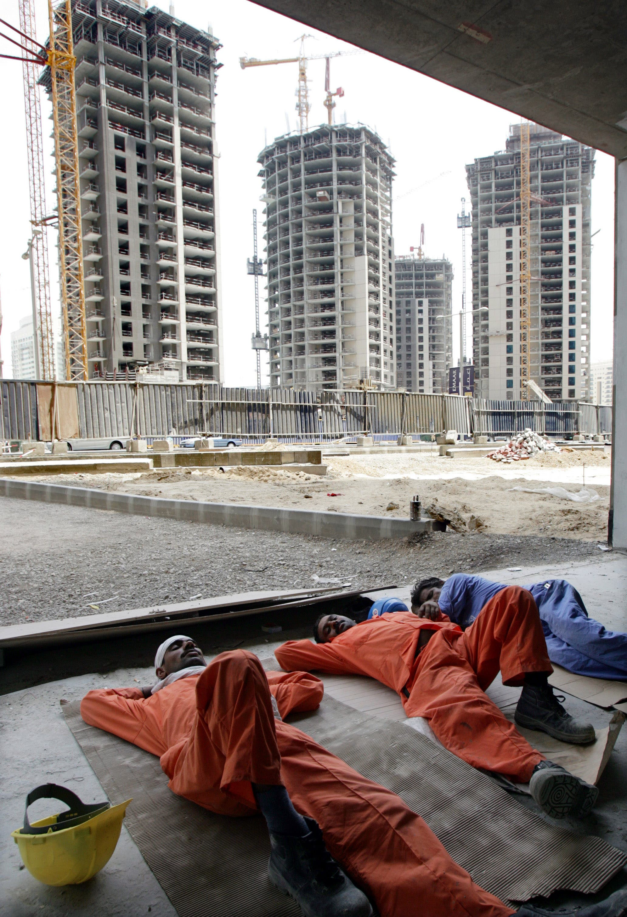 Workers take a nap on a hot afternoon at a construction site in Dubai. (File photo: Reuters)