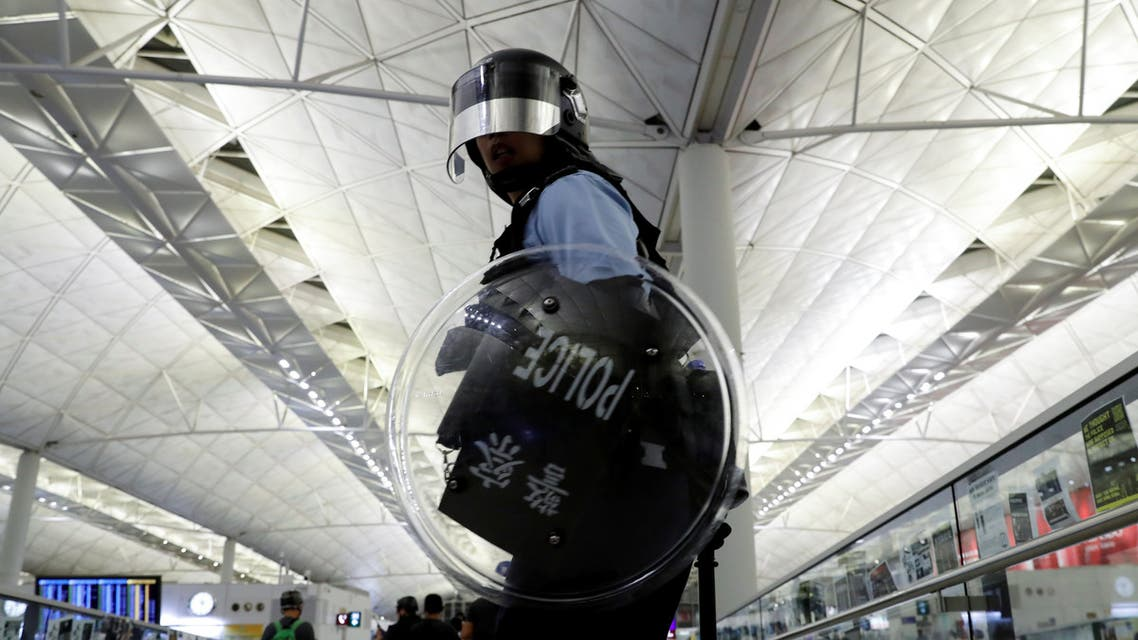 Riot police is seen during a mass demonstration after a woman was shot in the eye, at the Hong Kong international airport, in Hong Kong. (Reuters)