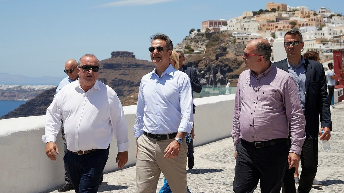 Greek PM Mitsotakis visits the town of Fira, following the easing of measures against the coronavirus on the island of Santorini, Greece, June 13, 2020. (Reuters)
