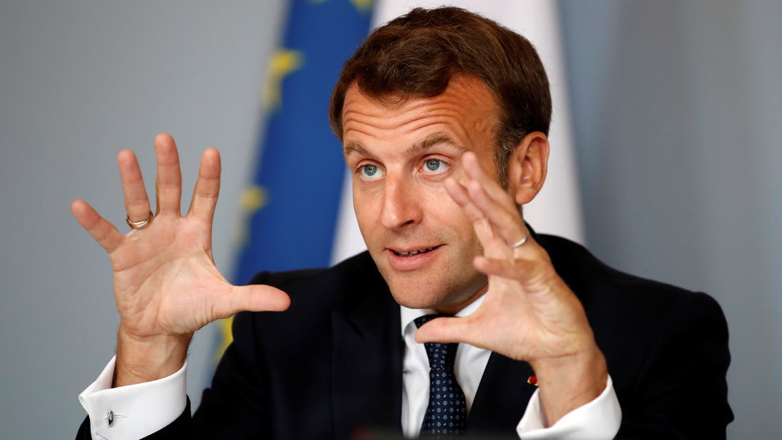 French President Emmanuel Macron gestures as he attends an international videoconference on vaccination at the Elysee Palace in Paris on the 49th day of a lockdown in France aimed at curbing the spread of COVID-19, caused by the novel coronavirus.