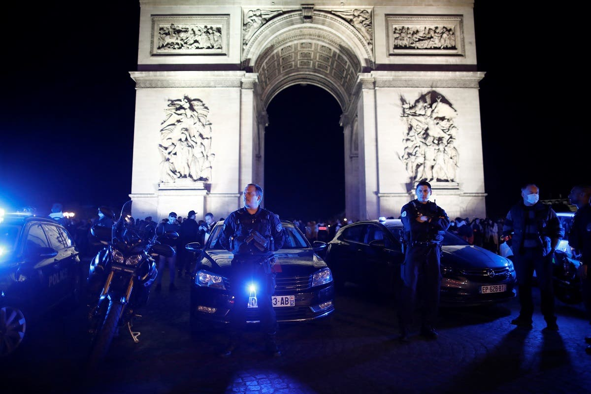 Police officers demonstrate against French Interior Minister Christophe Castaner's reforms following the death in police custody of George Floyd, near Arc de Triomphe in Paris, France, June 14, 2020. (Reuters)
