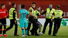 Pitch invader and Messi performance highlight Barca win over Mallorca