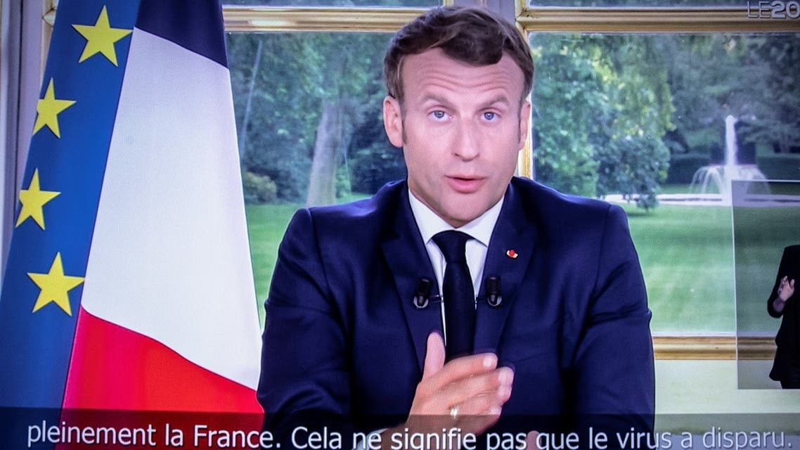 French President Emmanuel Macron is seen on a television screen in Paris on June 14, 2020 as he addresses the nation from the Elysee Palace during a televised speech, broadcast by French tv channel TF1. (AFP)