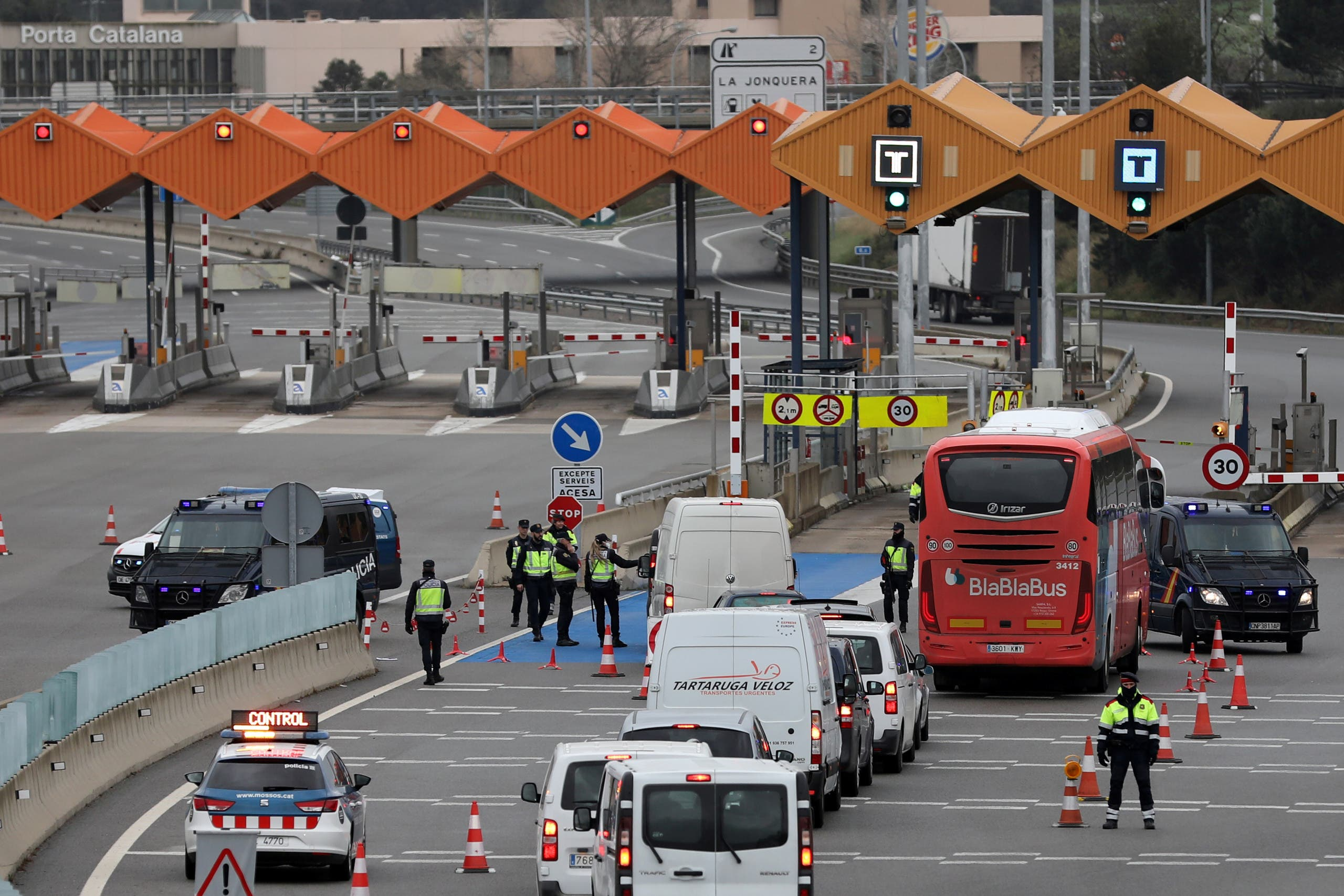Border police officers check vehicles at the last toll gate entering Spain from France, following an order from the Spanish government to set up controls at its land borders over coronavirus. (Reuters)