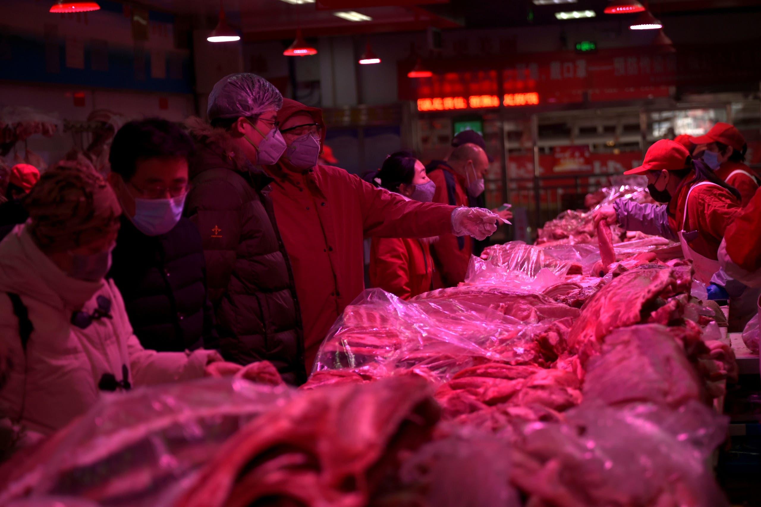 سوق تسينفادي لبيع الأغذية في العاصمة الصينية (أرشيفية- فرانس برس)