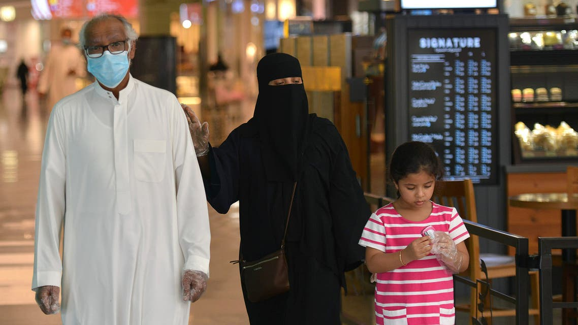 Saudi Arabian couple with child at the mall in Riyadh, June 4, 2020. (AFP)