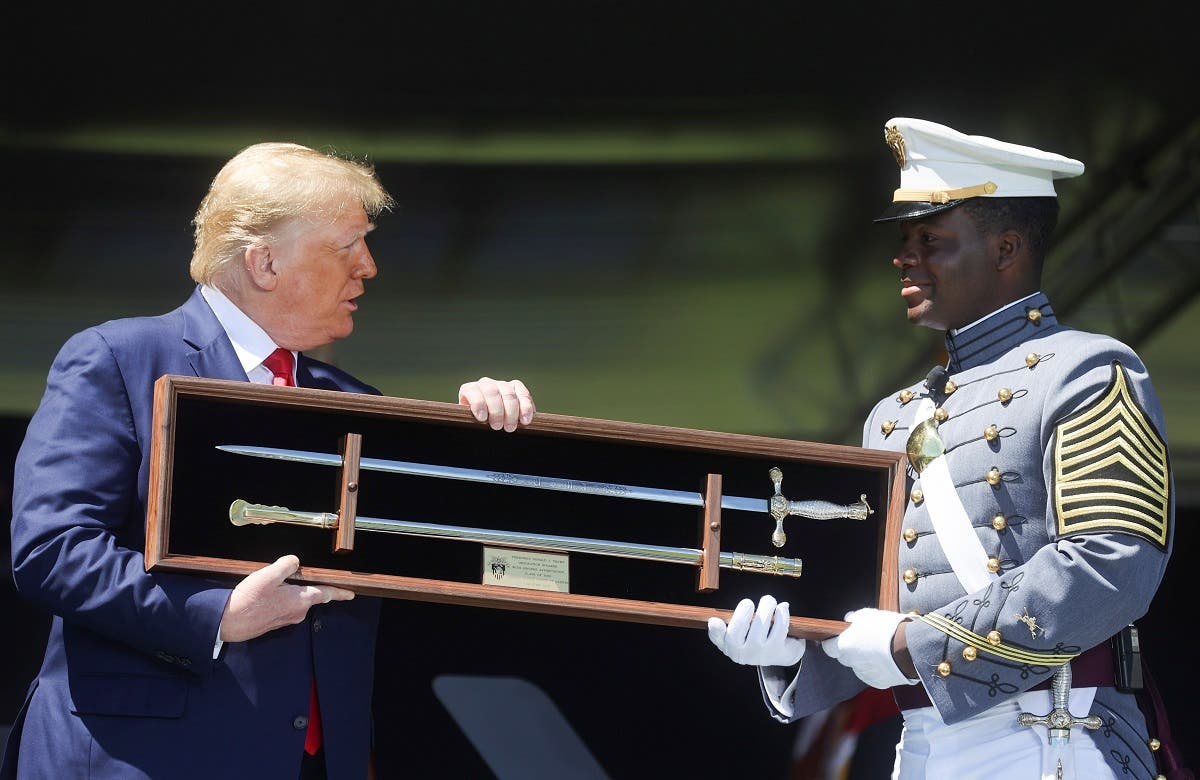 West Point 2020 Class President Joshua Phillips presents US President Donald Trump with a sabre as a class gift as the president attends to deliver the commencement address at the 2020 United States Military Academy Graduation Ceremony at West Point, New York, US, June 13, 2020. (Reuters)