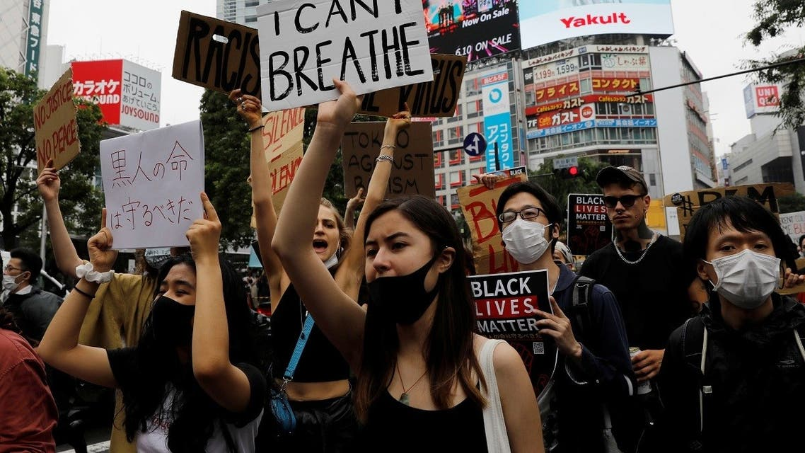 People wearing face masks march during a Black Lives Matter protest following the death in Minneapolis police custody of George Floyd, in Tokyo, Japan June 14, 2020. (Reuters)