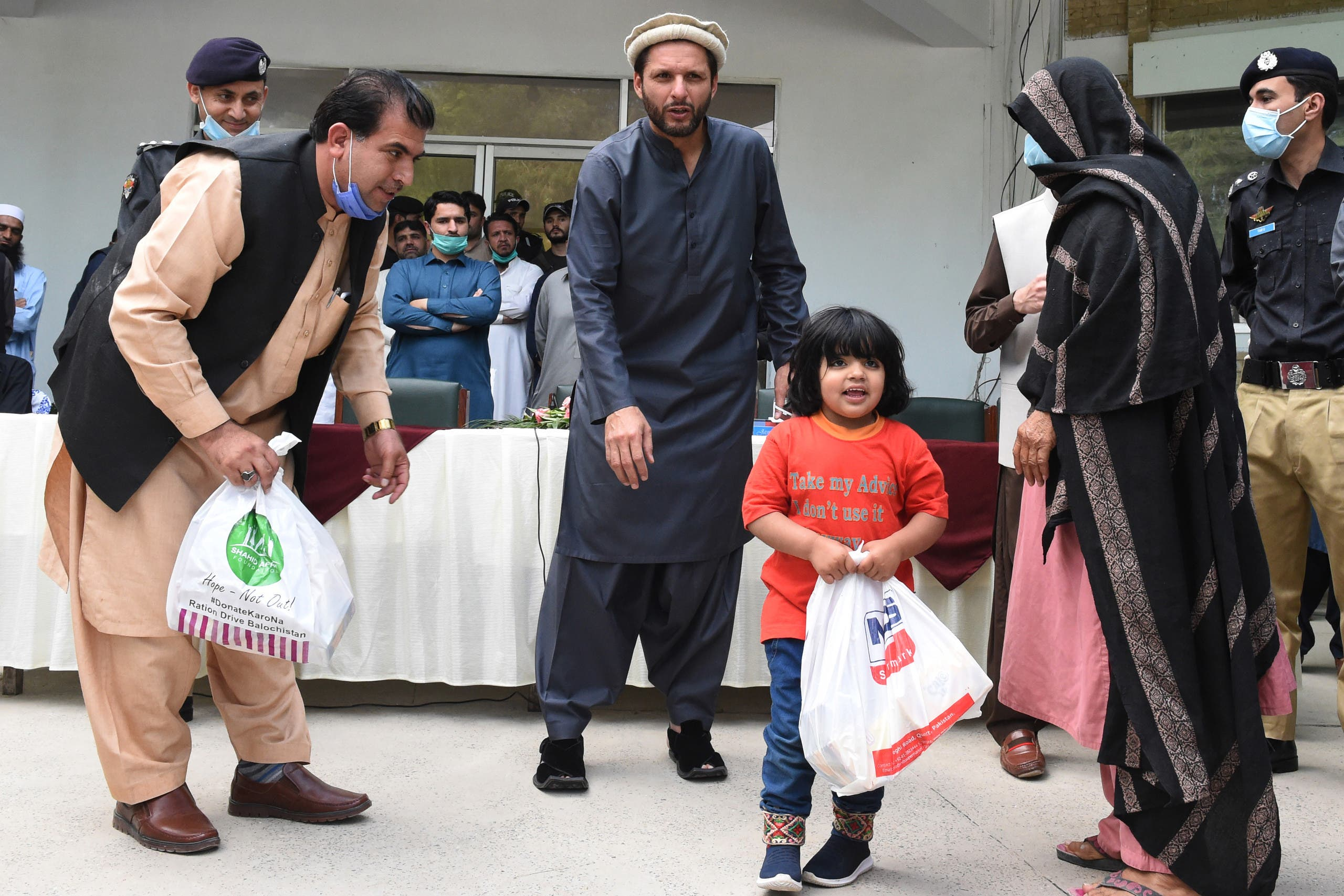 Shahid Afridi distributes rations to families during the coronavirus lockdown, May 4, 2020. (AFP)