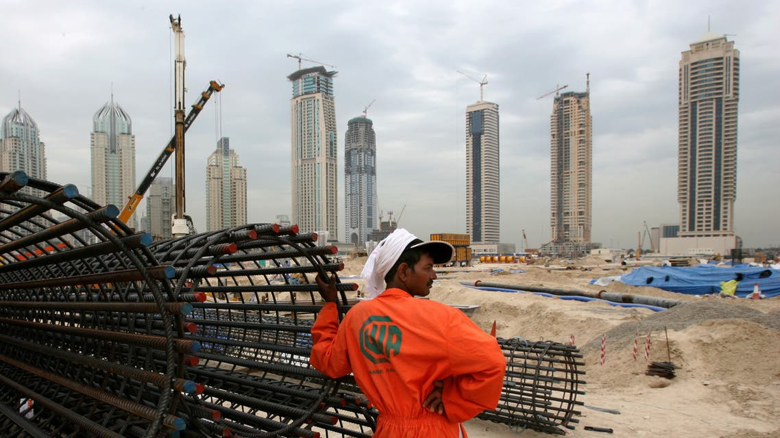 A construction worker rests at a site in Dubai. (Reuters)