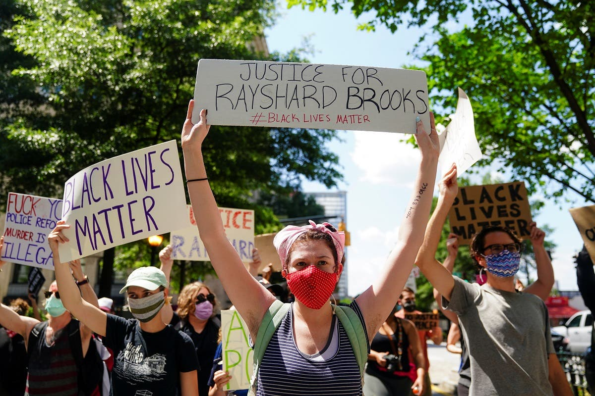 Protesters rally against racial inequality and the police shooting death of Rayshard Brooks, in Atlanta, Georgia, US June 13, 2020. (Reuters)