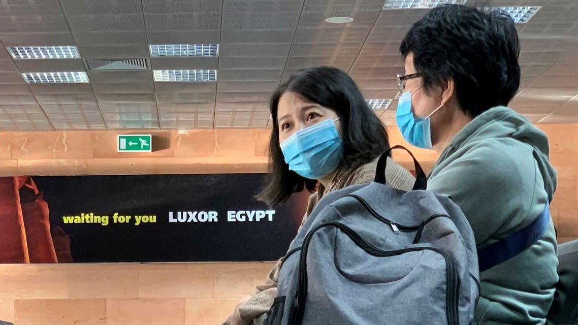 Passengers wear protective masks following the outbreak of the coronavirus disease (COVID-19) at Luxor International Airport in Luxor, Egypt. (File photo: Reuters)