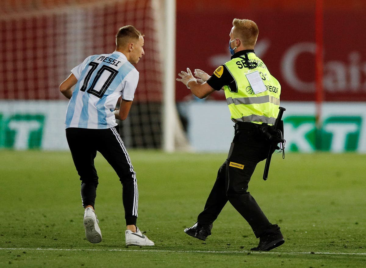 A fan invades the pitch during the match, as play resumes behind closed doors following the outbreak of the coronavirus disease. (Reuters)