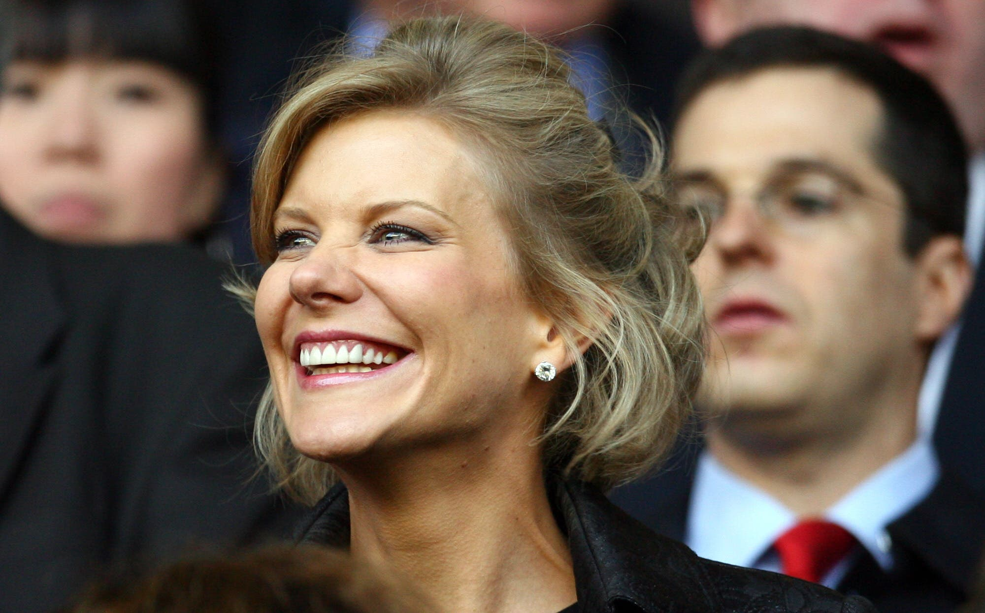 DIC negotiator Amanda Staveley takes her seat before Liverpool took on Chelsea in their UEFA Champions League semi-final football match against Liverpool at Anfield in Liverpool, north west England, April 22, 2008. (AFP)