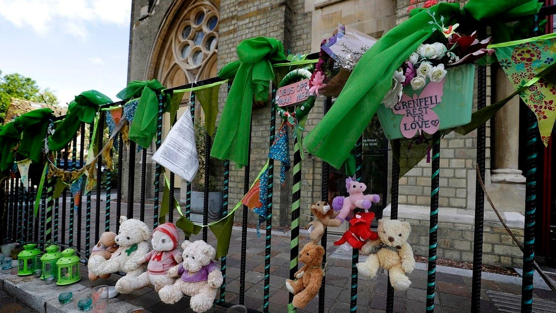 Tributes are tied to the railings outside Notting Hill Methodist Church near Grenfell Tower in London, Sunday, June 14, 2020. (AP)
