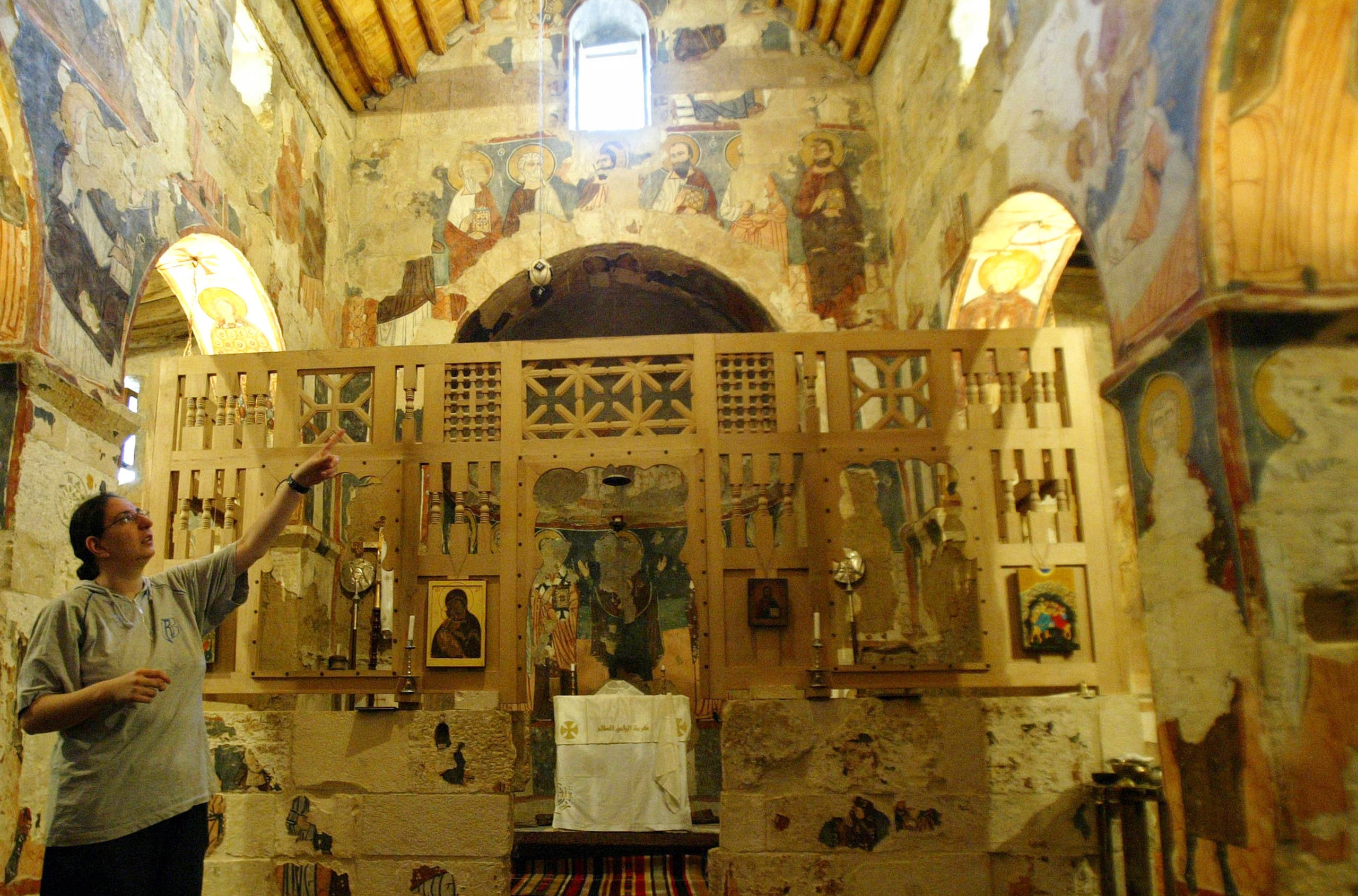 Sister Dima shows icons in the historic church of the Syrian Maronite monastery of Deir Mar Musa on July 11, 2007. (AFP)