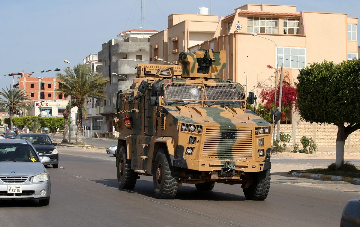 A Turkish-made armoured personnel vehicle, drives down a street in the Libyan coastal city of Sorman on April 13, 2020. (AFP)