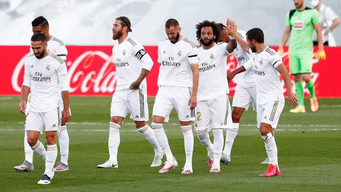 Real Madrid's Sergio Ramos celebrates scoring their second goal with teammates, as play resumes behind closed doors following the outbreak of the coronavirus disease. (Reuters)