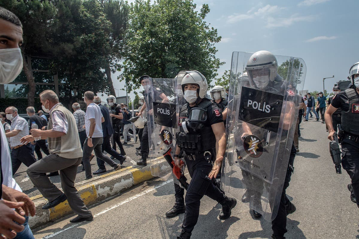 "Demonstrators clash with Turkish riot police during a ""March for Democracy"" called by HD), after three opposition MPs were revoked and sent to prison at Silivri, in Istanbul, on June 15, 2020. (AFP)"