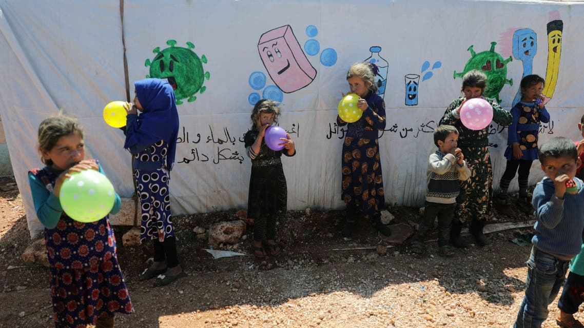 Displaced children play with balloons during an event organzied by Violet Organization, in an effort to spread awareness and encourage safety amid coronavirus disease (COVID-19) fears at a camp in Idlib. (Reuters)