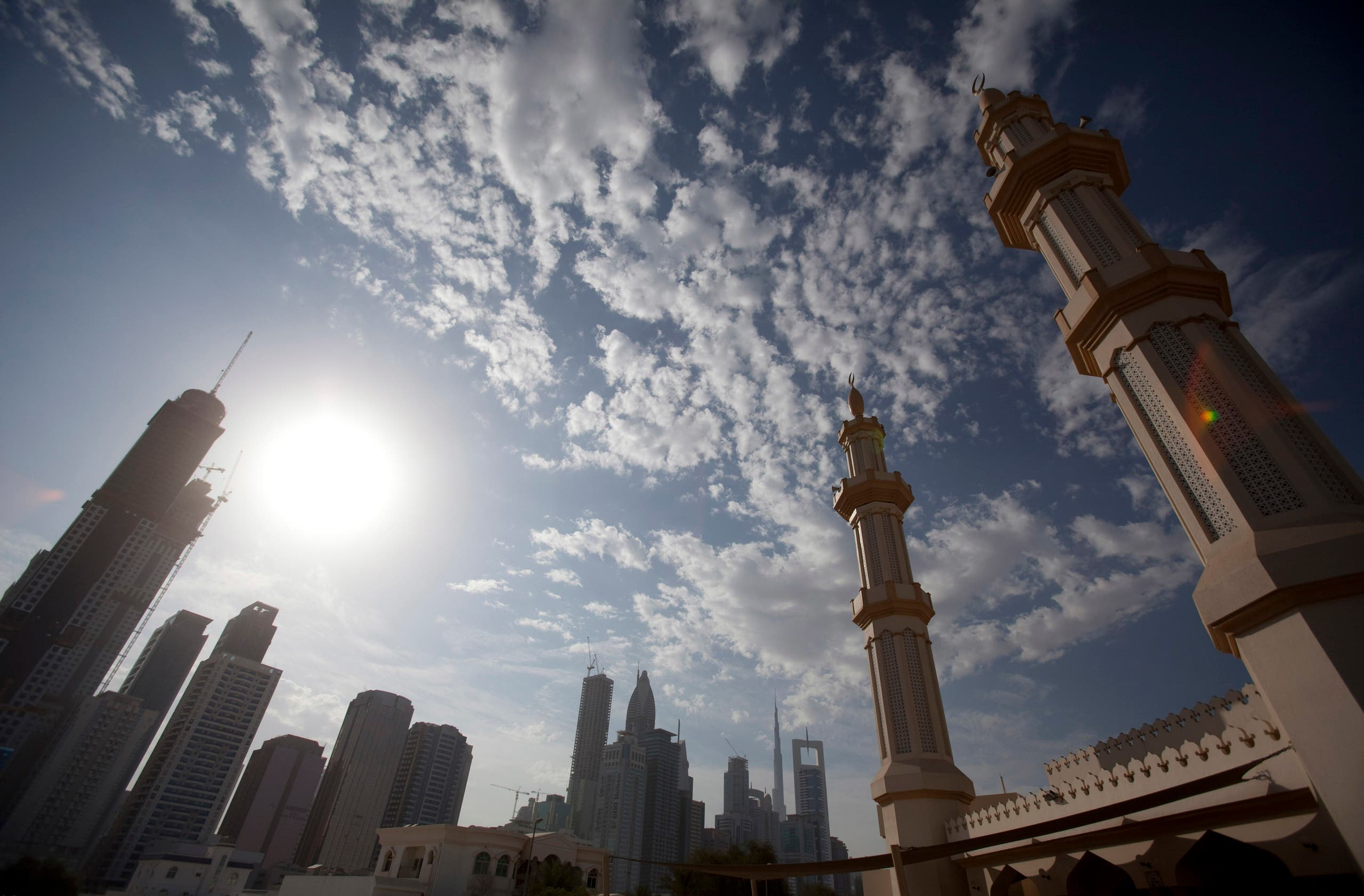 The twin minarets of a mosque are seen with office towers along Sheikh Zayed Road in Dubai. (AP)