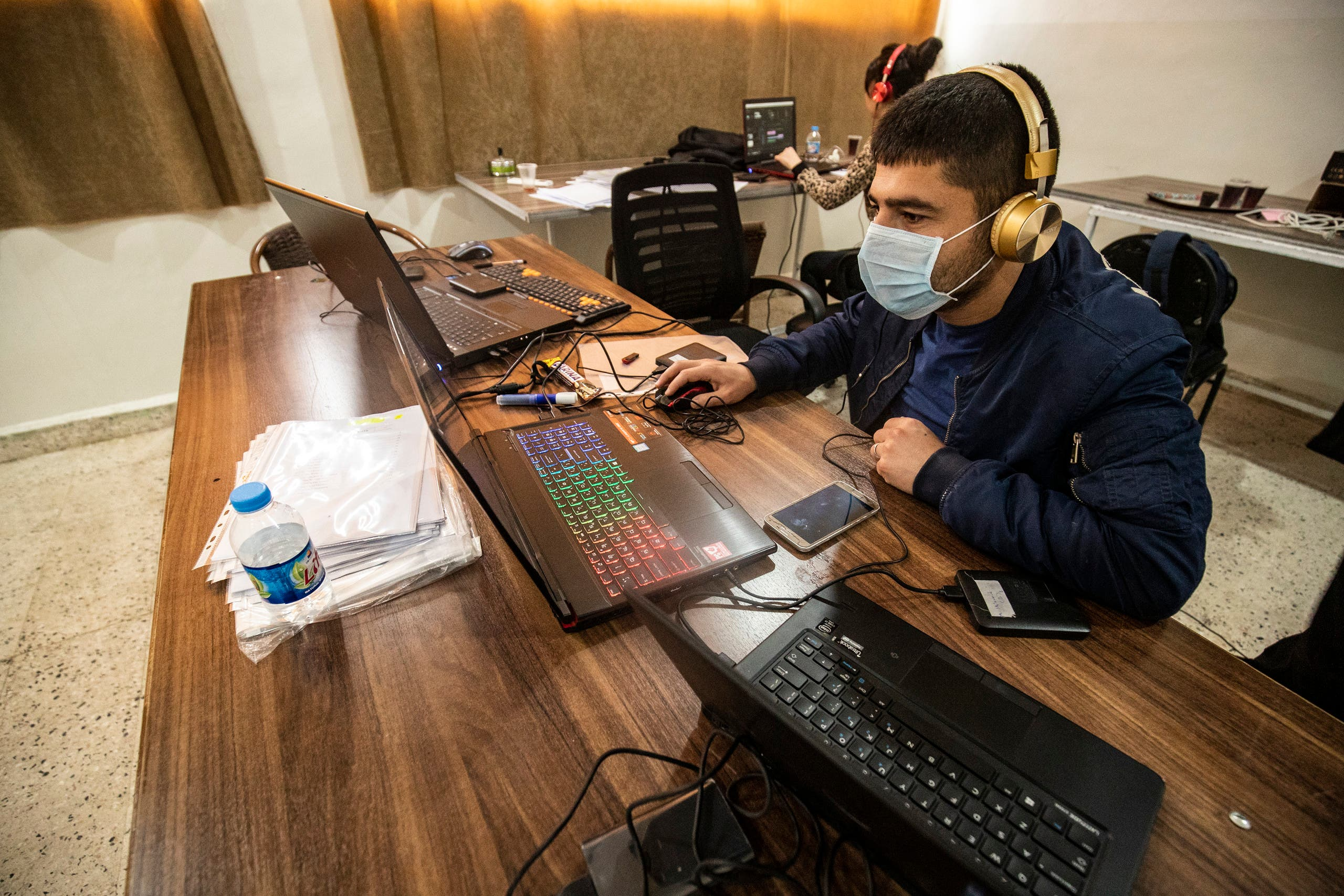 Technicians from the Kurdish educational authorities, edit and prepare recorded classes in Qamishli, northeast Syria, April 4. (AFP)