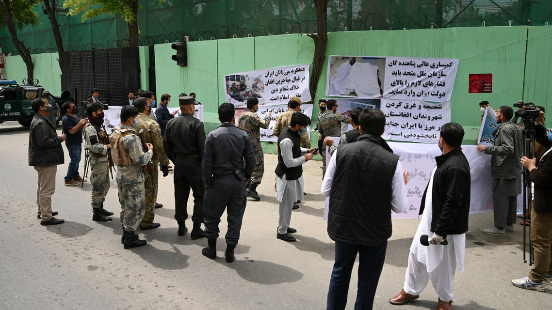Civil society activists hold banners and shout slogans against the Iranian government during a protest in front of the Iranian embassy in Kabul on May 11, 2020. Afghanistan has recovered 18 bodies of migrants who were allegedly beaten and tortured before being forced into a river by Iranian border guards last week, a senior Afghan official said on May 8. Afghan authorities are investigating claims the migrants drowned while illegally crossing into neighbouring Iran from western Herat province.
