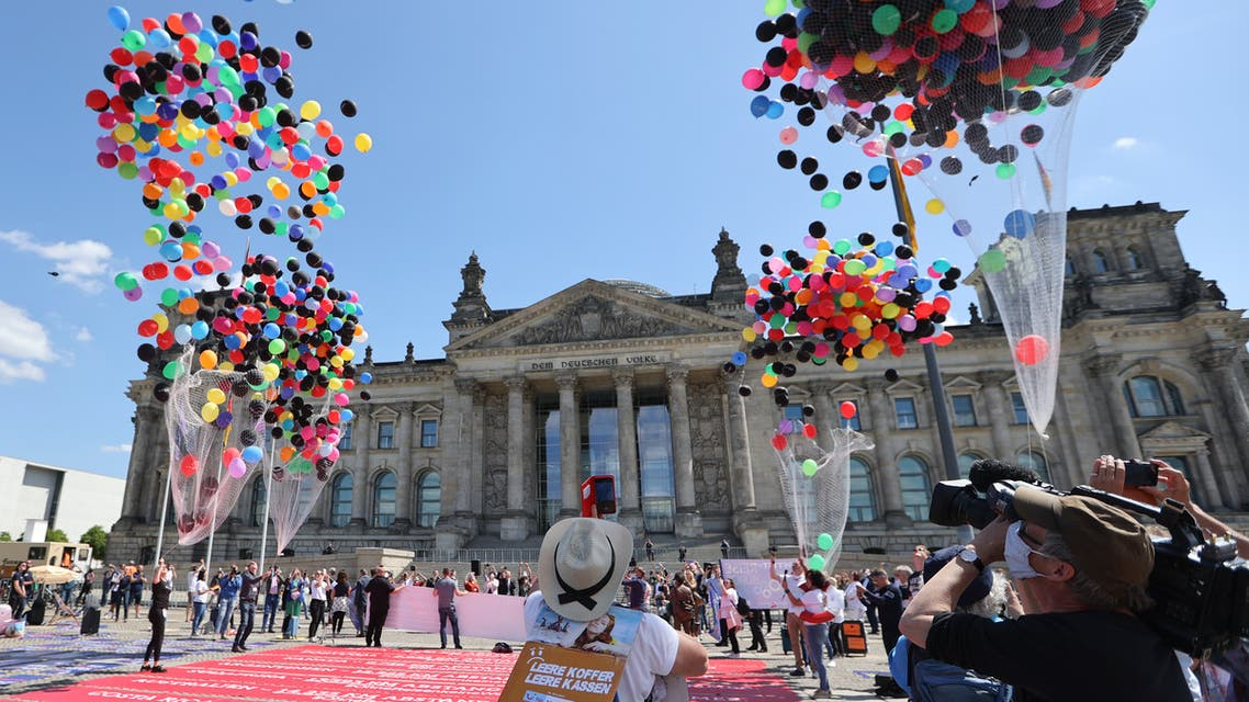 Members of travel agencies and the tourism industry participate in a demonstration in front of the lower house of German parliament, Bundestag, demanding financial help from the government, amid the spread of the coronavirus disease (COVID-19) in Berlin, Germany, May 27, 2020. (Reuters)