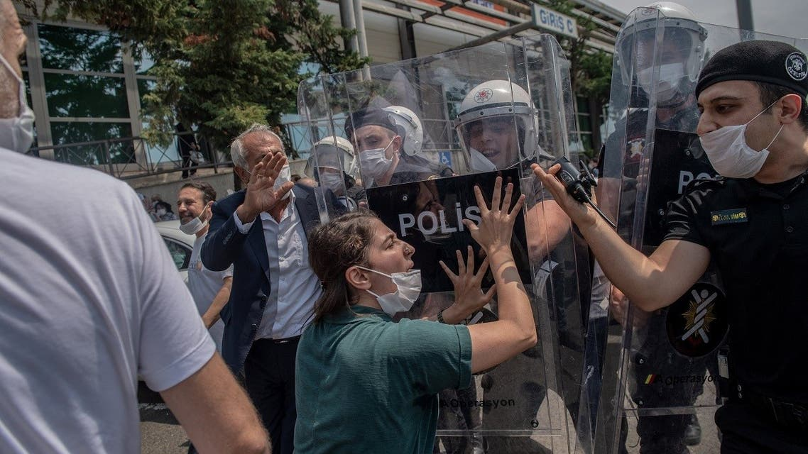HDP deputy Tuma Celik clash with Turkish riot police in Istanbul, on June 15, 2020. (AFP)