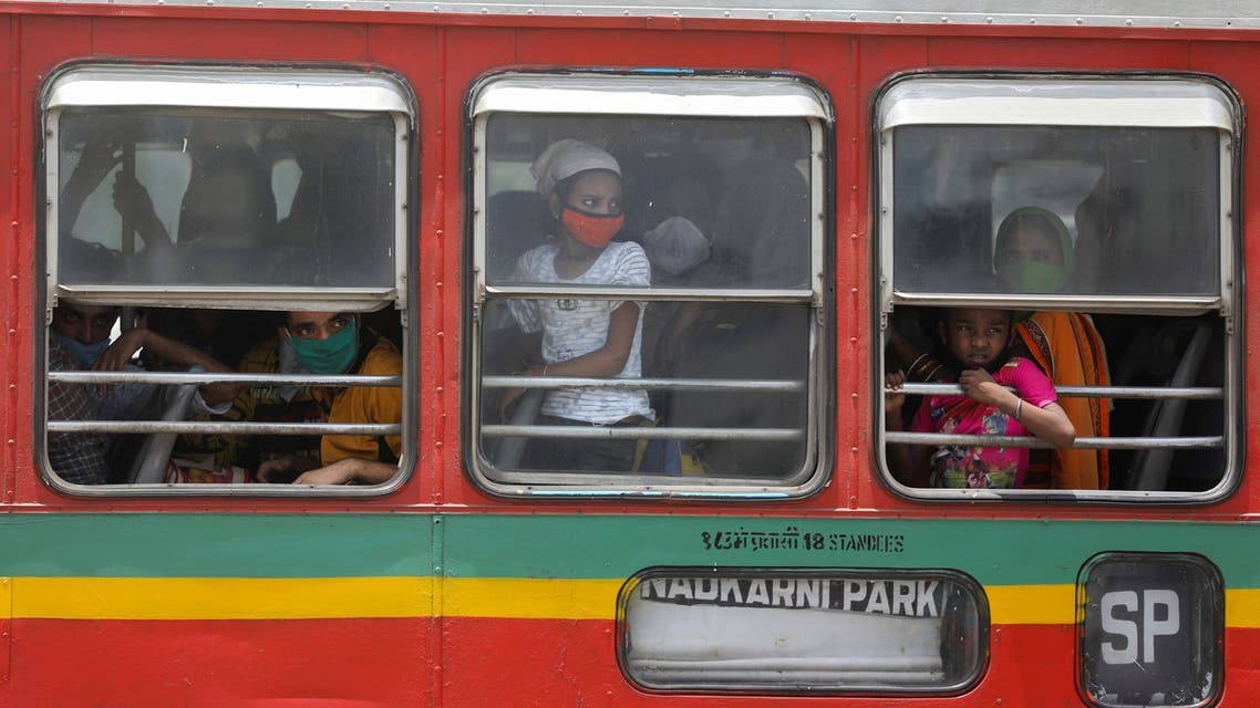 Migrants arrive at a railway station in a bus to board a train to their home state of Uttar Pradesh during an extended lockdown to slow the spread of the coronavirus disease (COVID-19), in Mumbai. (reuters)