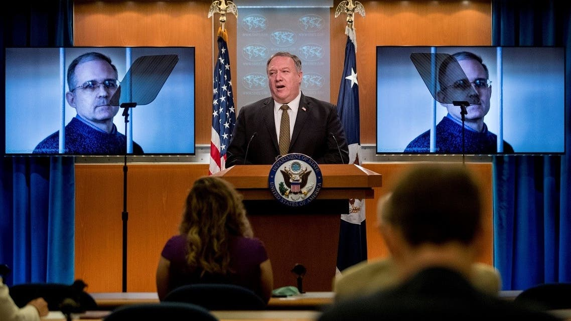In this file photo taken on June 10, 2020 an image of Paul Whelan is displayed behind Secretary of State Pompeo during a news conference in Washington, DC. (AFP)