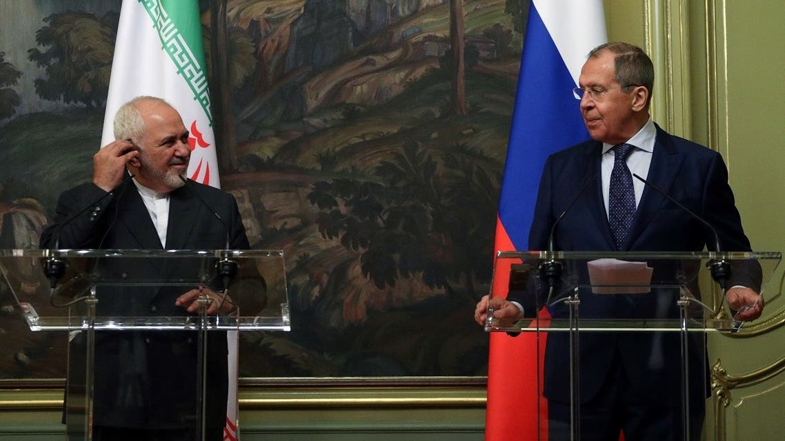 Russian Foreign Minister Sergei Lavrov and his Iranian counterpart Mohammad Javad Zarif hold a press conference following their meeting in Moscow on June 16, 2020. (AFP)