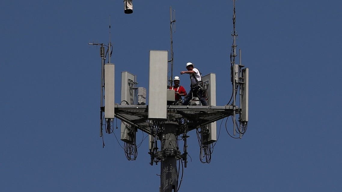 Workers install 5G telecommunications equipment on a T-Mobile tower in Seabrook, Texas. (Reuters)