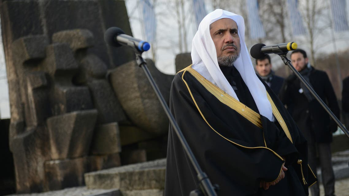 Dr. Mohammad Al-Issa, Secretary General of the Muslim World League speaks next to the memorial monument in the former German Nazi death camp Auschwitz-Birkenau on January 23, 2020. (AFP)