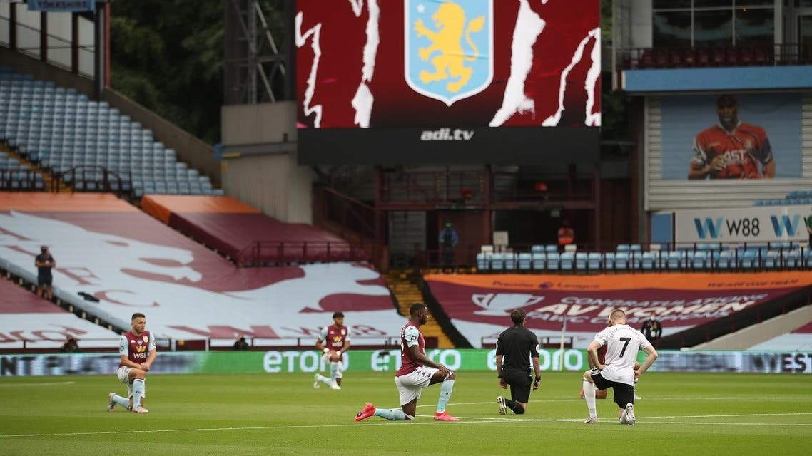 General view as players of Aston Villa and Sheffield United kneel in support of the Black Lives Matter campaign before the match as play resumes behind closed doors. (Reuters)