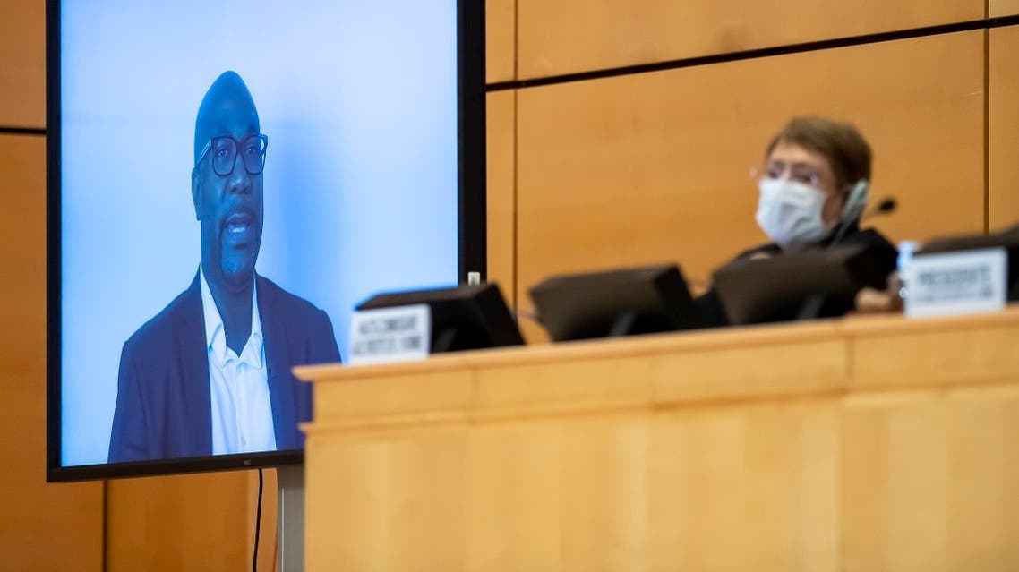 United Nations High Commissioner for Human Rights Michelle Bachelet (R) looks on next to a TV screen showing George Floyd's brother, Philonise Floyd speaking via video message on June 17, 2020 in Geneva. (AFP)