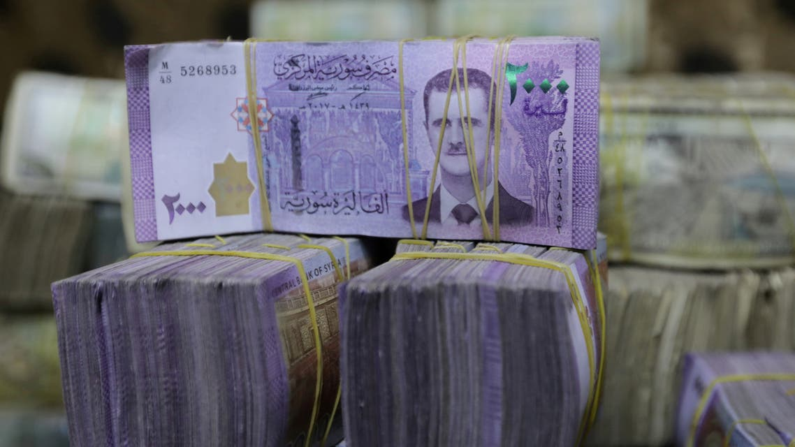 Syrian pounds are pictured inside an exchange currency shop in Azaz, Syria February 3, 2020. (Reuters)