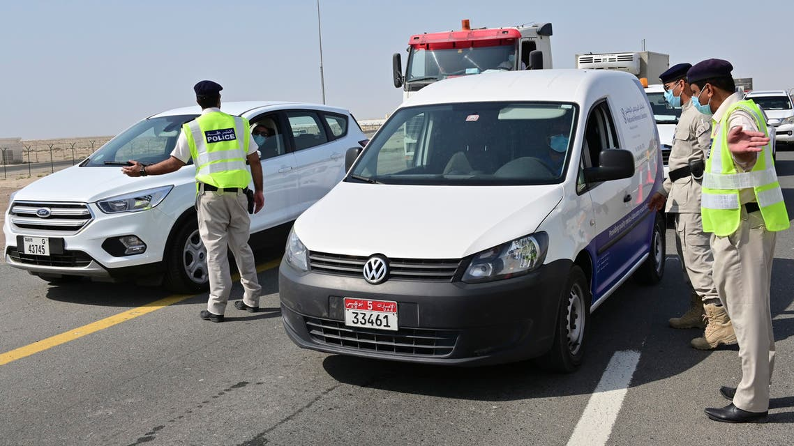Emirati security forces man a checkpoint at the entrance of Abu Dhabi, on the highway linking Dubai to the capital, on June 2, 2020, after authorities cordoned off the city for a week to rein in the novel coronavirus.