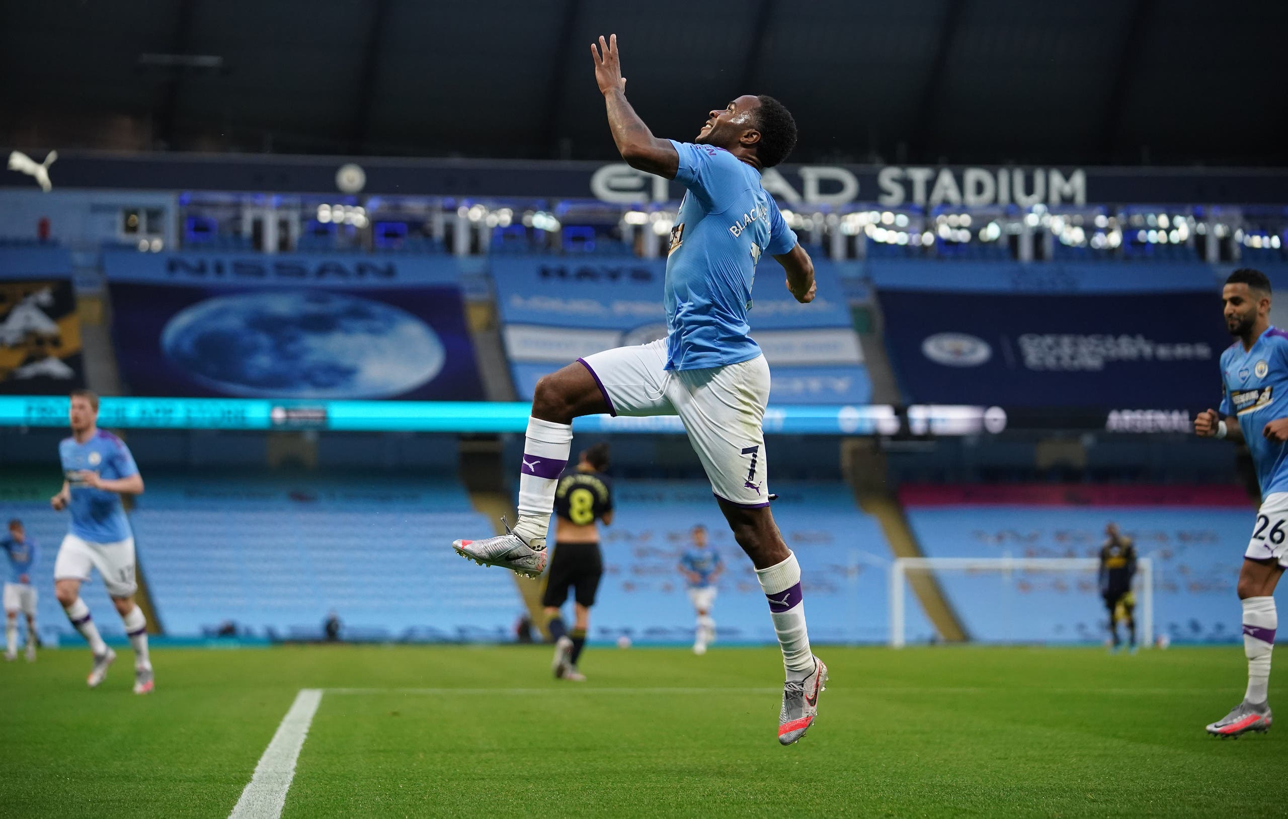 Raheem Sterling celebrates scoring for Manchester City against Arsenal, June 17, 2020. (AFP)