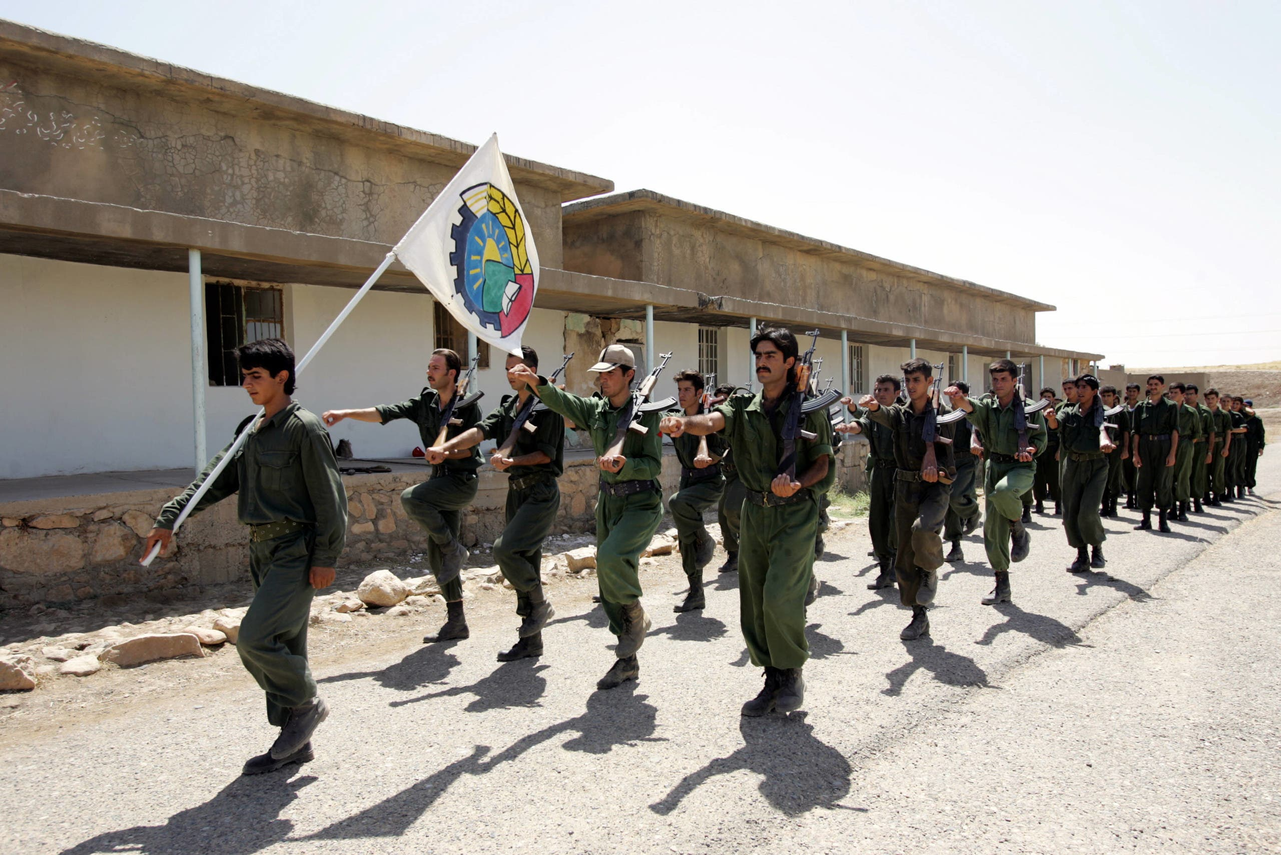 Pesmerga of the Democratic Party of Iranian Kurdistan (PDKI) march during military training at camp Koysancak in Sulaymaniyah in Iraq, 13 August 2005.  (AFP)
