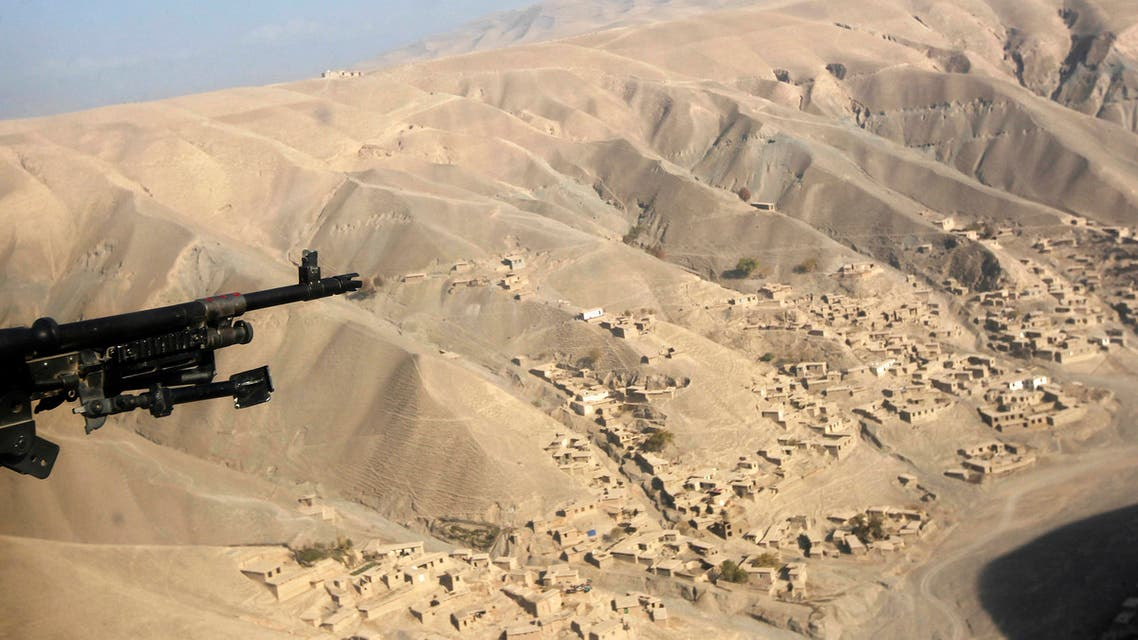 A US helicopter flies near the gold mine site in Nor Aaba in Takhar province, November 26, 2010. (Reuters)