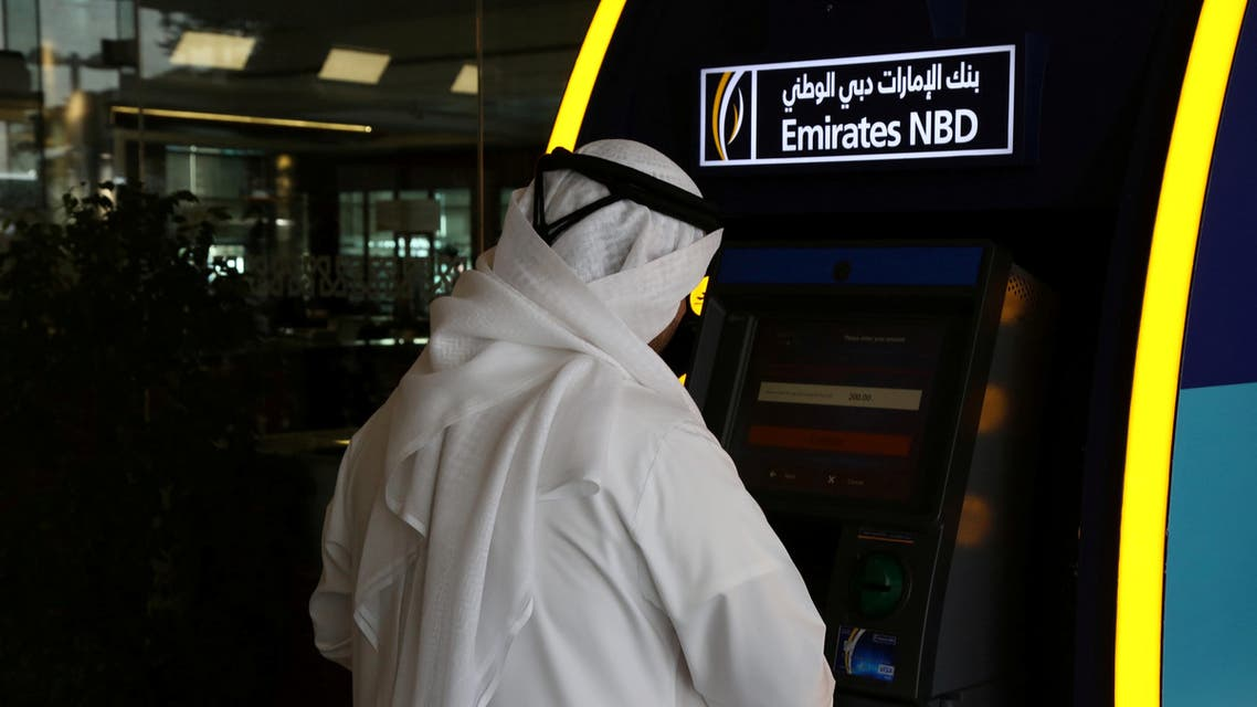 A customer uses an ATM machine at the Emirates NBD head office in Dubai, UAE. (File photo: Reuters)