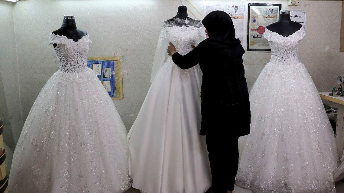 A worker adjusts a display of wedding dresses in downtown Tehran, Iran. (File photo: AP)