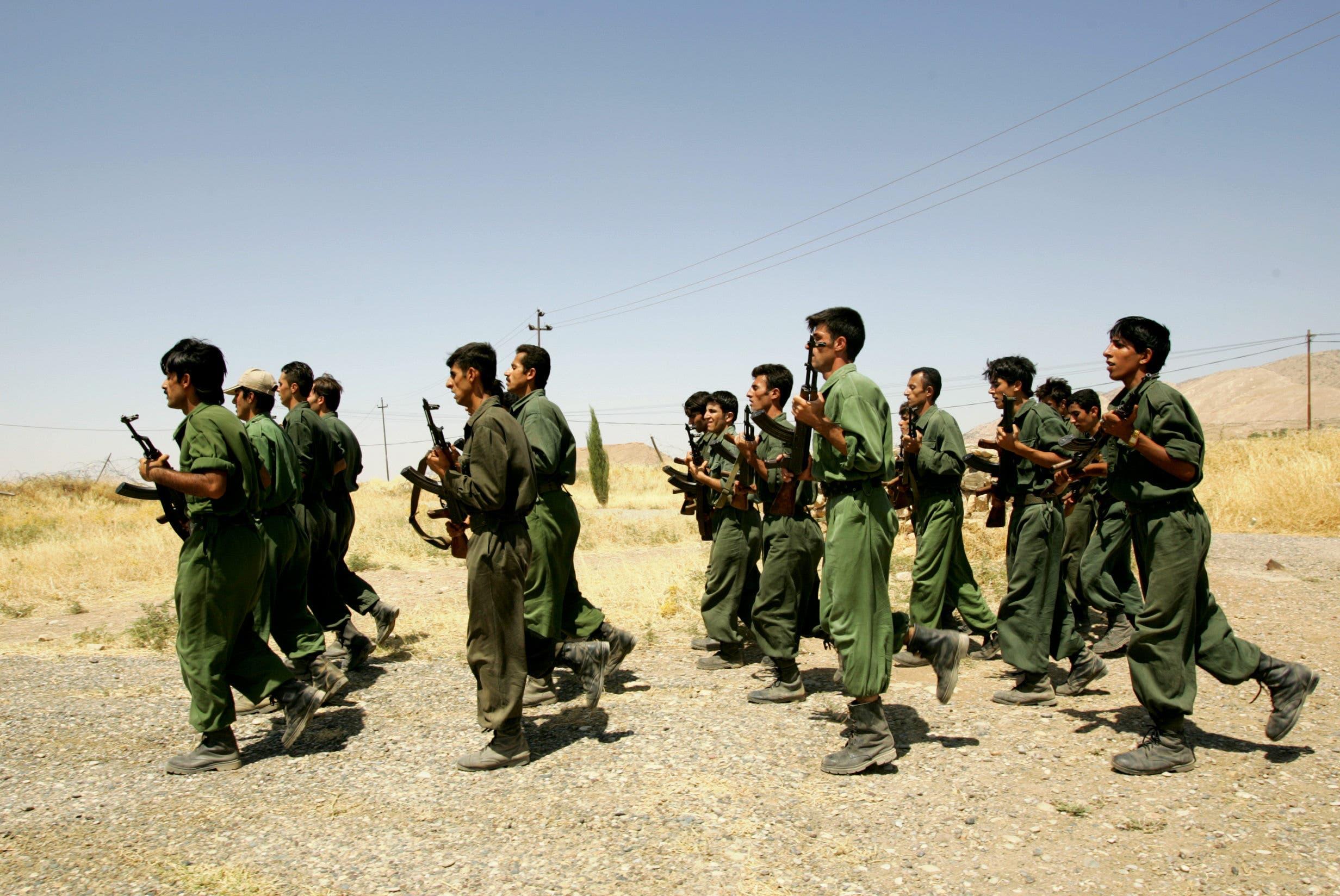 Pesmerga of the Democratic Party of Iranian Kurdistan (PDKI) train during military training at camp Koysancak in Sulaymaniyah in Iraq, 13 August 2005.  (AFP)