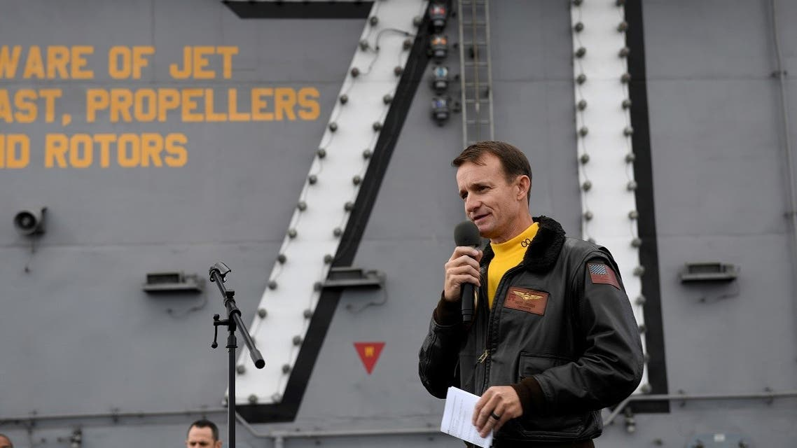 Captain Brett Crozier, commanding officer of the U.S. Navy aircraft carrier USS Theodore Roosevelt, speaks at sea. (Reuters)