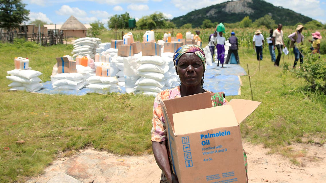 Villagers collect food aid distributed by the World Food Program (WFP) following a prolonged drought in rural Mudzi district, Zimbabwe, February 20, 2020. Picture taken February 20, 2020. REUTERS/Philimon Bulawayo