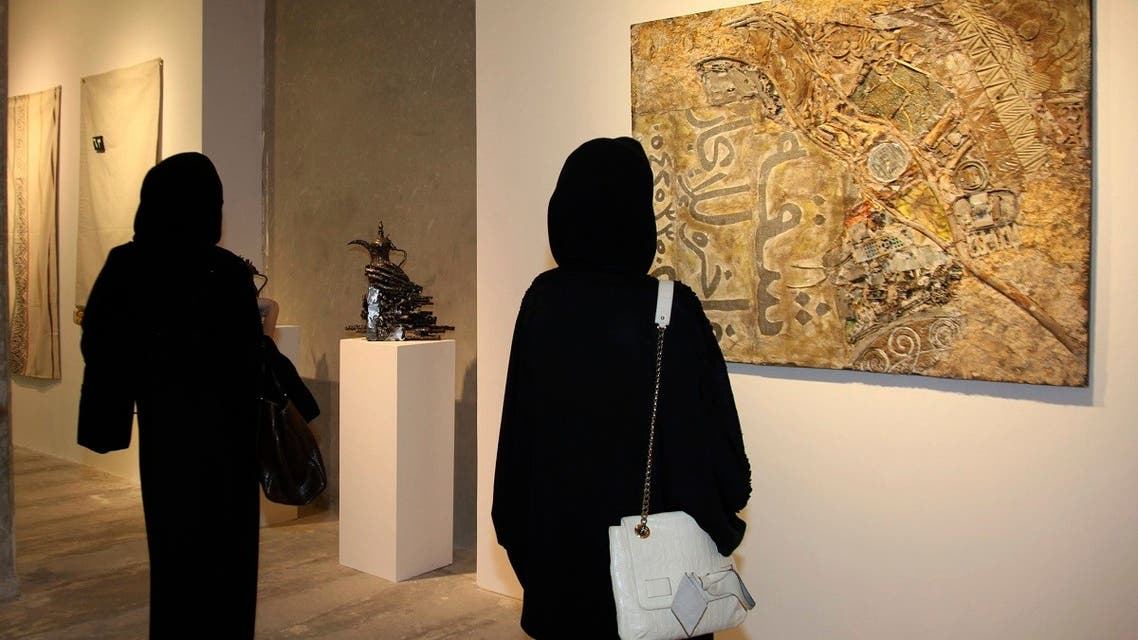 Visitors look at an artwork during Saudi Arabia?s first public show of contemporary art entitled We need to talk at al Furusia Marina in Jeddah. (File photo: Reuters)