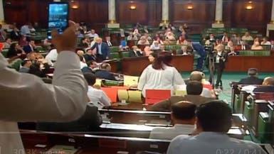 صورة محمد مرسي تثير تلاسنا وفوضى في برلمان تونس
